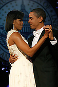 Washington, DC - January 20, 2009 -- United States President Barack Obama and First Lady Michelle Obama dance during the Neighborhood Inaugural Ball at the Washington Convention Center on January 20, 2009 in Washington, DC. Obama became the first African-American to be elected to the office of President in the history of the United States. .Credit: Chip Somodevilla - Pool via CNP