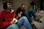 Blind Pilot lead singer Israel Nebeker, left, and bassist Luke Ydstie, right, wait for the rain to slacken before hitting the road in Leggett, CA on September 19, 2008.