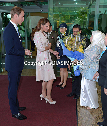 """CATHERINE, DUCHESS OF CAMBRIDGE AND PRINCE WILLIAM.are greeted on arrival at Changi Airport, at the start of their 2-day Tour of Singapore_11/09/2012.Mandatory credit photo: ©DIASIMAGES..""""No UK Sales Until 9th October 2012""""..(Failure to credit will incur a surcharge of 100% of reproduction fees)..                **ALL FEES PAYABLE TO: """"NEWSPIX INTERNATIONAL""""**..IMMEDIATE CONFIRMATION OF USAGE REQUIRED:.DiasImages, 31a Chinnery Hill, Bishop's Stortford, ENGLAND CM23 3PS.Tel:+441279 324672  ; Fax: +441279656877.Mobile:  07775681153.e-mail: info@newspixinternational.co.uk"""