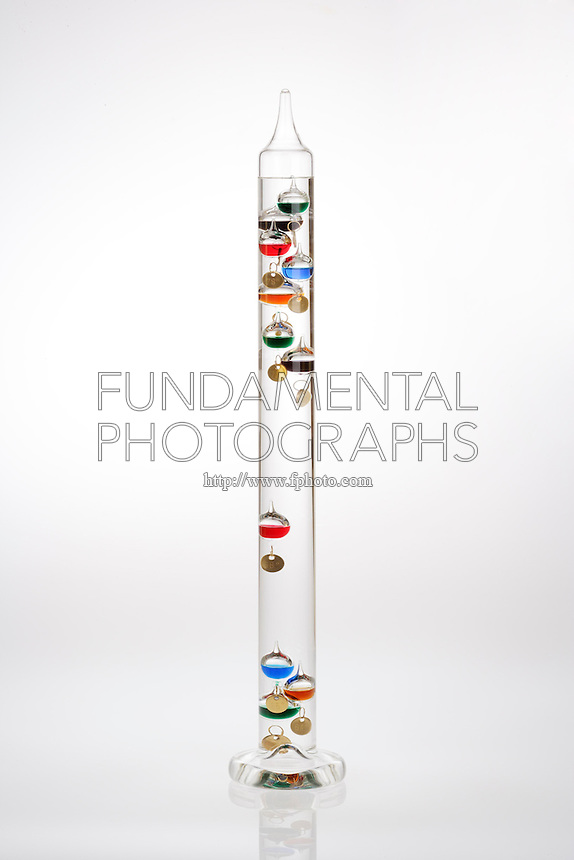 GALILEO THERMOMETER OR TERMOMETRO LENTOS<br /> Principle of Galileo's Thermoscope<br /> Specifically weighted bubbles float in a sealed glass cylinder. When temperature of the containing liquid changes, the glass balls rise or sink, staying where their density matches. The last bubble to rise to the top marks the temperature.