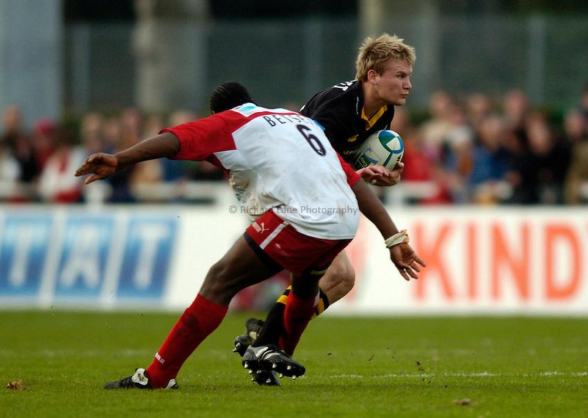 Photo: Richard Lane..Biarritz Olympique v London Wasps. Heineken Cup. 15/01/2005..Serge Betsen trips Stuart Abbott, resulting in Abbott breaking his leg.