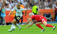 Inka Grings (l) of Germany and Sophie Schmidt of Canada during the FIFA Women's World Cup at the FIFA Stadium in Berlin, Germany on June 26th, 2011.