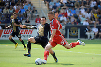 Chad Barrett (19) of Toronto FC takes a shot as Danny Califf (4) of the Philadelphia Union defends during a Major League Soccer (MLS) match at PPL Park in Chester, PA, on July 17, 2010.