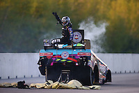 Jun 3, 2016; Epping , NH, USA; Smoke comes from the car of NHRA funny car driver Courtney Force as she reacts after an engine fire during qualifying for the New England Nationals at New England Dragway. Mandatory Credit: Mark J. Rebilas-USA TODAY Sports