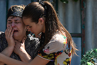 Woman cries at the funeral of her daughter killed by shelling in Donetsk, Ukraine.