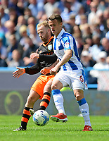 Sheffield Wednesday's Barry Bannan vies for possession with Huddersfield Town's Jonathan Hogg<br /> <br /> Photographer Chris Vaughan/CameraSport<br /> <br /> The EFL Sky Bet Championship Play-Off Semi Final First Leg - Huddersfield Town v Sheffield Wednesday - Saturday 13th May 2017 - The John Smith's Stadium - Huddersfield<br /> <br /> World Copyright &copy; 2017 CameraSport. All rights reserved. 43 Linden Ave. Countesthorpe. Leicester. England. LE8 5PG - Tel: +44 (0) 116 277 4147 - admin@camerasport.com - www.camerasport.com