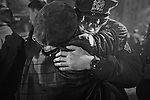 12,21,2014. Yunghi Kim/Contact Press Images. Brooklyn resident Melissa Plowden-Norman went and hugged every police officer at the corner of Myrtle and Tompkins Ave, the site of the shooting of officers Wenjian Liu and Rafael Romos, now turned into a memorial site.  <br /> Bedford Stuyvesant Brooklyn.