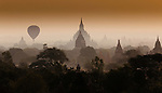 Hot-air balloon floats through the hazy skies of Bagan, Myanmar