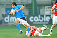 Bradley Davis of Wales (right) tries to tackle Andrea Masi of Italy by pulling his shorts during  the Six Nations International rugby match between Italy and Wales at the Stadio Flaminio in Rome, Italy on February 26, 2011.