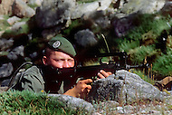 July, 1980, Calvi Area, Corsica, France. Training of the 2nd REP, Foreign Regiment of Paratroopers. They are based in Corsica and are trained for all kinds of combat. Legionnaire holding the F.A.M.A.S, French assault gun.