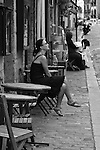 A woman smokes a cigarette outside a cafe in Montmartre district. Paris, France. July 29, 2007.