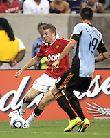 Sebastien Le Toux #19 of the MLS All-Stars watches Tom Cleverley #35 of Manchester United during the 2010 MLS All-Star match at Reliant Stadium, on July 28 2010, in Houston, Texas. MANU won 5-2.