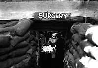 In an underground surgery room, behind the front lines on Bougainville, an American Army doctor operates on a U.S. soldier wounded by a Japanese sniper.  December 13, 1943.  Attributed to Miller. (Army)<br /> NARA FILE #:  111-SC-187247<br /> WAR &amp; CONFLICT BOOK #:  918