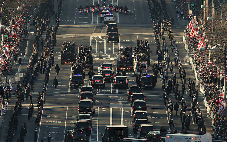 The presidential motorcade takes part in the Inaugural parade on its way down Pennsylvania Ave. from the US Capitol on January 21, 2013, in Washington, DC. US President Barack Obama and Vice President Joe Biden were sworn in for a second term and are will watch the parade from a viewing stand in front of The White House.   AFP PHOTO/Molly RILEY...