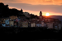Sun setting over a small medieval village in Umbria, Italy