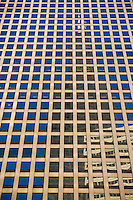 """Abstract reflection of the Willis Tower on the facade of a modern skyscraper. The architecture of Chicago has influenced and reflected the history of American architecture. The city of Chicago, Illinois features prominent buildings in a variety of styles by many important architects. Since most buildings within the downtown area were destroyed by the Great Chicago Fire in 1871, Chicago buildings are noted for their originality rather than their antiquity..Beginning in the early 1880s, architectural pioneers of the Chicago School explored steel-frame construction and, in the 1890s, the use of large areas of plate glass. These were among the first modern skyscrapers and amongst their most famous architects were William LeBaron, John Wellborn Root Sr., Daniel Burnham and Charles Atwood. Louis Sullivan was perhaps the city's most philosophical architect. Realizing that the skyscraper represented a new form of architecture, he discarded historical precedent and designed buildings that emphasized their vertical nature. This new form of architecture, by Jenney, Burnham, Sullivan, and others, became known as the """"Commercial Style,"""" but it was called the """"Chicago School"""" by later historians..Since 1963, a """"Second Chicago School"""" emerged, largely due to the ideas of structural engineer Fazlur Khan. Some of Chicago's skyscrapers such as the John Hancock Center, Willis Tower (formerly known as the Sears Tower) and The Trump International Hotel and Tower are amongst the tallest buildings in the world."""