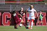 15 October 2016: Florida State's Macayla Edwards (18) knocks the ball away from NC State's Ricarda Walkling (GER) (7). The North Carolina State University Wolfpack hosted the Florida State University Seminoles at Dail Soccer Field in Raleigh, North Carolina in a 2016 NCAA Division I Women's Soccer match. FSU won the game 1-0.