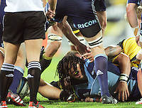 Ma'a Nonu looks up from a ruck during the Super 15 rugby match between the Hurricanes and Blues at Westpac Stadium, Wellington, New Zealand on Friday, 4 May 2012. Photo: Dave Lintott / lintottphoto.co.nz