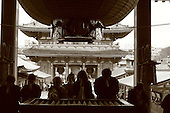Mar 6, 2006; Tokyo, JPN; Asakusa.Visitors toss coins in the wooden coffer (front) and pray at the Senso-ji Buddhist temple.  ..The Hozo-mon (treasure gate) can be seen  in the background...Photo credit: Darrell Miho