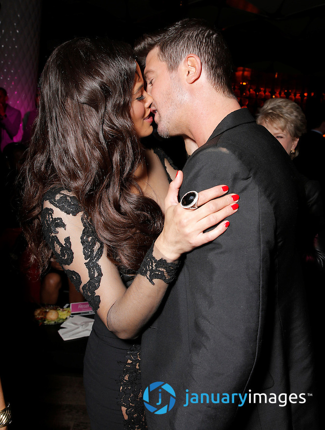 "Paula Patton and Robin Thicke kiss at the after party for Fox Searchlight's Los Angeles Premiere of ""Baggage Claim"" , on Wednesday, September 25, 2013 in Los Angeles. (Photo by Todd Williamson/Invision for Fox Searchlight/AP Images)"
