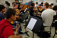 Lindsay, California, September 5, 2012 - Students in Nancy Willis' Advanced Guitar class learn Flamenco guitar. Lindsay High School began building a competency-based education model about 7 years ago, fully implementing it just over three years ago and is set to graduate its first class this school year. This model does away with traditional grading and pass/fail for grades. Instead students are expected to achieve proficiency in a range of areas in each class, where a 3 (equal to a traditional B) is passing; A 4 is considered intensive and usually denotes college bound. Says Principal Jaime Robles, ?This allows students to learn at there own pace. If a student is advanced, they can move ahead, and if a student is lagging, they get the support they need.? Part of this model allows for students who are more advanced dig deeper and push harder and truly move ahead of others. Because they are ahead, some spend the extra time learning more, others take concurrent classes at the nearby community college and some choose to graduate early to start their path. ?Each student has their own set of goals,? says English teacher Amalia Lopez, ?Whatever their goals are, we support them.?.Slug: DD_ CompetencyByline: Daryl Peveto / LUCEO for Education Week