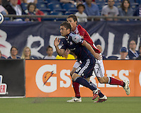 New England Revolution midfielder Chris Tierney (8) and Chivas USA forward Justin Braun (17) chase a pass. In a Major League Soccer (MLS) match, Chivas USA defeated the New England Revolution, 3-2, at Gillette Stadium on August 6, 2011.