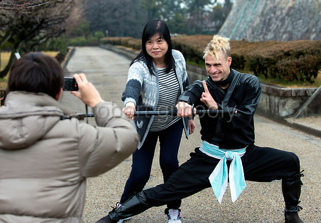 "Ninja Chris  ""Sora"" O'Neil has his photo taken with a visitor from Hong Kong in the grounds of Nagoya Castle, Aichi Prefecture Japan on Feb. 23, 2017. O'Neil is one of the eight ninja corps who roam the avenues of the castle and Nagoya Airport, jumping from behind trees and bushes to surprise visitors. ROB GILHOOLY PHOTO"