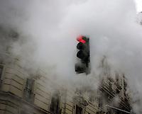 A traffic light in New York is engulfed by steam released by Con Edison on Saturday, March 14, 2015. (© Frances M. Roberts)
