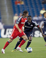 Toronto FC forward Alan Gordon (21) dribbles as New England Revolution midfielder Shalrie Joseph (21) defends. In a Major League Soccer (MLS) match, the New England Revolution tied Toronto FC, 0-0, at Gillette Stadium on June 15, 2011.