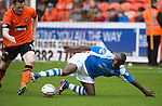 Dundee United v St Johnstone.....04.05.13      SPL.Gregory Tade and Jon Daly.Picture by Graeme Hart..Copyright Perthshire Picture Agency.Tel: 01738 623350  Mobile: 07990 594431