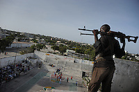 Death or Play. Women&acute;s Basketball in Mogadishu.Women's basketball? In Europa and the U.S., we take it for granted. But consider this: In Mogadishu, war-torn capital of Somalia, young women risk their lives every time they show up to play..Suweys, the captain of the Somali women&acute;s basketball team, and her friends play the sport of the deadly enemy, called America. This is why they are on the hit list of the killer commandos of Al Shabaab, a militant islamist group, that has recently formed an alliance with the terrorist group Al Qaeda and control large swathes of Somalia...Al Shabaab, who sets bombs under market stands, blows up cinemas, and stones women, has declared the female basketball players ?un-islamic?. One of the proposed punishments is to saw off their right hands and left feet. Or simply: shoot them...Suweys&acute; team trains behind bullet-ridden walls, in the ruins of the failed city of Mogadishu - protected by heavily armed gun-men. The women live in constant fear of the islamist killer commandos. Stop playing basketball? Never, they say..Women&acute;s basketball in the world&acute;s most dangerous capital..