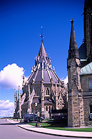 Parliament Buildings on Parliament Hill, in the City of Ottawa, Ontario, Canada - Library of Parliament (built 1876) at rear of Centre Block