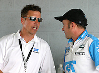 Scott Pruett, left, talks to a member of his pit crew during practice for the Miami 250 Grand-Am Rolex Series race at Homestead-Miami Speedway in Homestead, FL , Otober 9, 2009.  (Photo by Briain Cleary/www.bcpix.com)