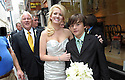 Former Governor Edwin Edwards and his new bride, Trina Grimes Scott and her 12-year-old son Trevor Scott, pose for photos after a ceremony in the French Quarter in New Orleans, La., Friday, July 29, 2011. The four-time ex-governor, who will be 84 next month, married 32-year-old Trina Grimes Scott in a simple private ceremony. (AP Photo/Cheryl Gerber)