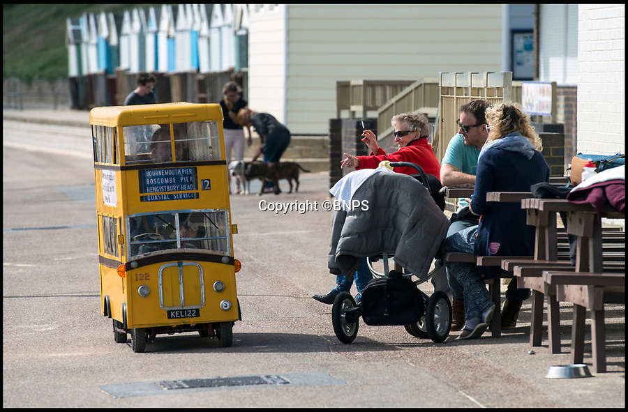 BNPS.co.uk (01202 558833)<br /> Pic: TomWren/BNPS<br /> <br /> Dinky decker...<br /> <br /> A retired bus driver has taken his passion for buses to the next level - by transforming a broken mobility scooter into a quirky mini yellow bus.<br /> <br /> Keith Burbidge, 75, retired as a coach driver last year but missed the mode of public transport so much he decided to make his own miniature version.<br /> <br /> The father-of-two spent just &pound;40 and six months turning a broken scooter he picked up at auction into a working scale-model of a Yellow Bus, the company that operates in his hometown of Bournemouth, Dorset.<br /> <br /> The one-of-a-kind motor is 4ft tall and 6ft long and can only travel at speeds of about 5mph.