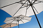 Close up of outdoor restaurant table umbrellas in Montauk NY