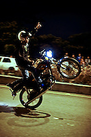 A motorcycle driver performs a pike at the zone known as las palmas in Medellin, Colombia. Jan 20, 2014. Adrenaline, danger and Noise come together, at nights to the sector of Las Palmas in Medellin. where an exhibition of pikes begins starring over a hundred motorcyclists which make their way in the middle of thousand of spectators round the road for don't lost any detail of the pirouettes. Photo by VIEWpress