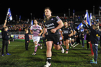 Nick Auterac and the rest of the Bath Rugby team run out onto the field. European Rugby Challenge Cup match, between Bath Rugby and Cardiff Blues on December 15, 2016 at the Recreation Ground in Bath, England. Photo by: Patrick Khachfe / Onside Images