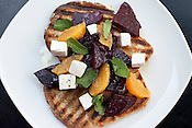 June 1, 2011. Durham, NC.. The bruchetta with roasted beets, ricotta salata, orange and mint.