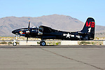 Mike Brown taxies his Grumman F7F Tigercat along the ramp prior to a heat race during the 2008 Reno National Championship Air Races at Stead Field in Nevada. There were 364 of the twin engined fighters built during World War II, and shortly thereafter, of which there are six that are still considered airworthy. Originally Grumman had been contracted to build 500 of the aircraft for use by the US Marine Corps to be used as close air support of the landing operations that were planned in the Pacific.