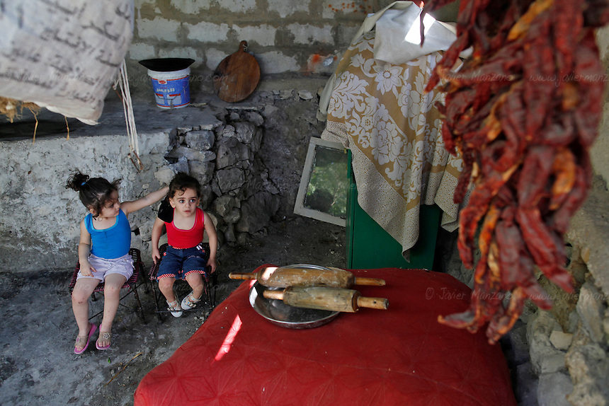 The Al Kassab region of northwestern Syria is considered the front line in the war against the Assad regime in this region of the country. This is the home to many sunni Muslims that are suffering the brunt of the shelling by the Assad army and air force - electricity was cut off months ago and basic food items along with petrol and potable water are increasingly in short supply. ..Still, the many groups that compose the Free Syria Army (FSA) in this region press on as the winter months approach. Most of the members of the FSA in this area are farmers, cell phone salesmen, clerks, carpenters, school teachers - most of them had little or no combat experience prior to joining the opposition army. Weapons and ammunition are also increasingly hard to come by as the price for bullets has skyrocketed since the conflict began 18 months ago. Rumors of an assault on this region by the Assad regime are part of everyday conversation in the villages that for the past few weeks have managed to keep the regime's army tanks and infantry out of their homes. ..© Javier Manzano