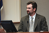 William Franklin, husband of sniper victim Linda Franklin, testifies during the trial of sniper suspect John Allen Muhammad in courtroom 10 at the Virginia Beach Circuit Court in Virginia Beach, Virginia on October 30, 2003. <br /> Credit: Adrin Snider - Pool via CNP