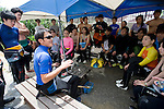 Volunteers participating in the Team Tyura Sango coral reef restoration project attend a briefing prior to a dive to plant coral in the bay at Onna Village, Okinawa Prefecture, Japan, on Saturday, June 23, 2012. Photographer: Robert Gilhooly