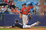 Auburn's Creede Simpson is safe at third as Ole Miss' Zach Miller looks around during the Southeastern Conference tournament at Regions Park in Hoover, Ala. on Friday, May 28, 2010.  (AP Photo/Oxford Eagle, Bruce Newman)