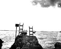 Carrying scaling ladders, U.S. Marines in landing crafts head for the seawall at Inchon.  September 15, 1950.  S.Sgt. W. W. Frank.  (Marine Corps)<br /> NARA FILE #:  127-N-A3189<br /> WAR &amp; CONFLICT BOOK #:  1418