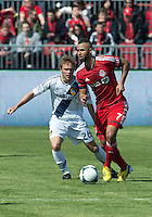 30 March 2013:Toronto FC midfielder John Bostock #7 and Los Angeles Galaxy midfielder Michael Stephens #26 in action during an MLS game between the LA Galaxy and Toronto FC at BMO Field in Toronto, Ontario Canada..The game ended in a 2-2 draw..
