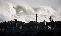 Large waves pound Island Bay on Wellington's south coast as people gather on the nearby rocks to spectate & take photos.