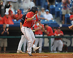 Ole Miss' Taylor Hashman scores behind Auburn's Ryan Jenkins (6) on Ole Miss' Mike Snyder's hit during the Southeastern Conference tournament at Regions Park in Hoover, Ala. on Friday, May 28, 2010.  (AP Photo/Oxford Eagle, Bruce Newman)