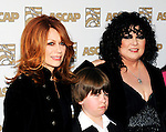Nancy Wilson and Ann Wilson of Heart with Ann Wilson's son at the 2009 ASCAP Pop Awards at the Renaissance Hotel in Hollywood, April 22, 2009...Photo by Chris Walter/Photofeatures.