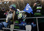 Seattle Seahawks fan Casey Crust plants a kiss on Taima, an African Augur Hawk during a championship celebration at  CenturyLink Field with Seahawks players, coaches, and staff on February 5, 2014 in Seattle. Crust was one of thousands of fans who braved temperatures in the mid-20's to greet the team after the club's 43-8 victory over the Denver Broncos in Super Bowl XLVIII.     ©2014. Jim Bryant Photo. ALL RIGHTS RESERVED.